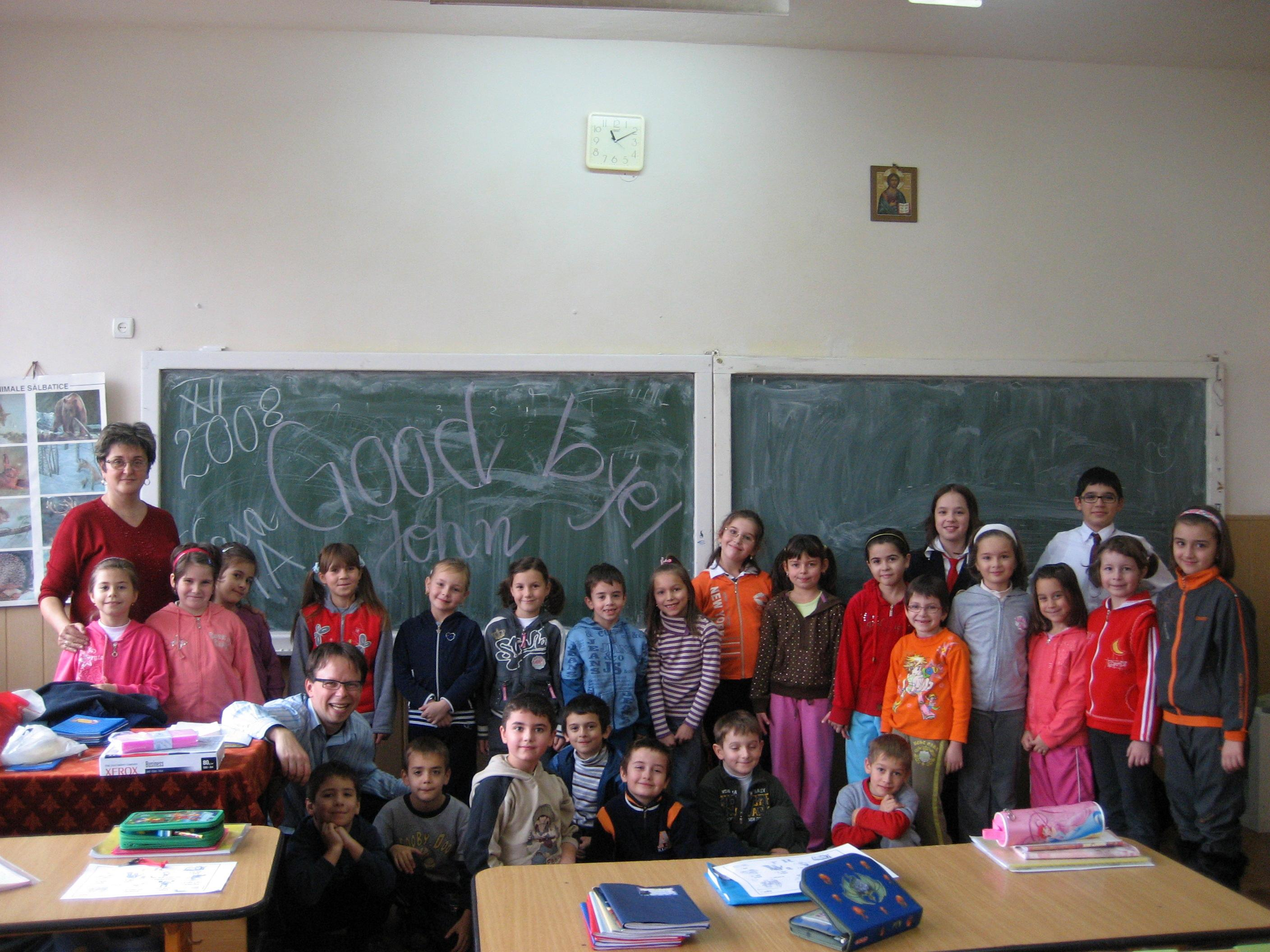 Projects Abroad volunteer and her students pose for a photo to mark the end of her teaching work experience in Romania